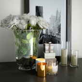 Picture, candles and a vase with roses