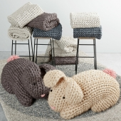 Knitted hares, stool with plaids and carpet
