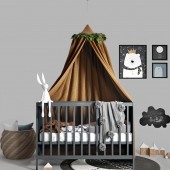 Canopy bed with pompom blanket