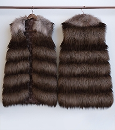 Fur vest on a hanger and on a dummy